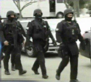 Prosecutor: Suspect admits having weapons