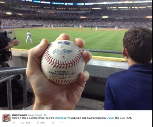 Ball-hawking fan won't give A-Rod back No. 3,000