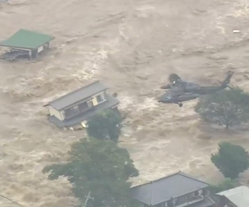 Two dead, 170,000 evacuated due to tropical storm in Japan; town submerged