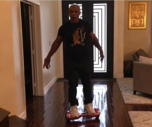 Hot pink hoverboard takes down Mike Tyson