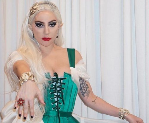 Lady Gaga dresses as 'Santa's naughty elf' for holiday party