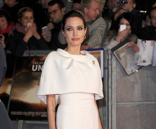 Angelina Jolie to receive aviation award at a ceremony hosted by John Travolta