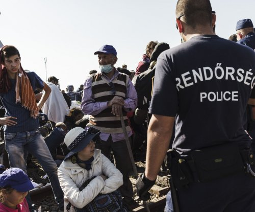 European Commission president proposes quotas to distribute 120,000 refugees