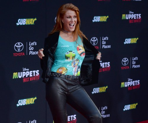 Angie Everhart files for divorce from Carl Ferro