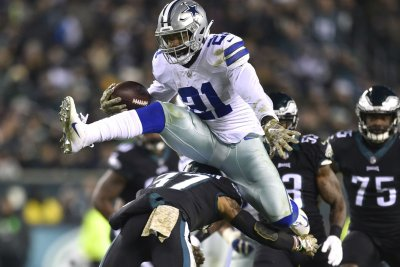 Former state champion hurdler Ezekiel Elliott hops Eagles defender