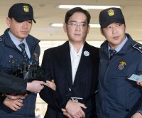 Samsung chief accepts prison term for bribery scandal