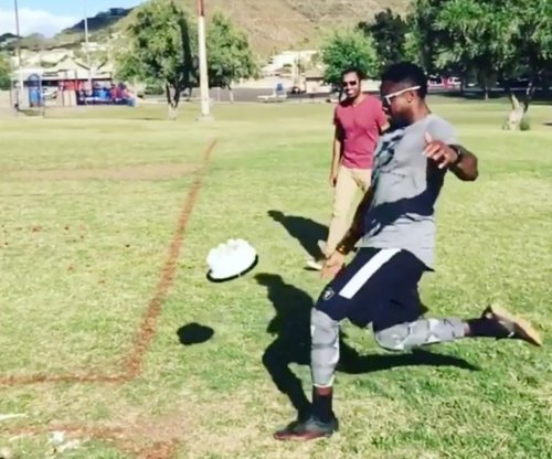 Watch: Oakland Raiders' Marquette King punts Derek Carr's birthday cake