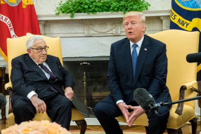 Trump taps 'immense talent' of Henry Kissinger at White House meeting