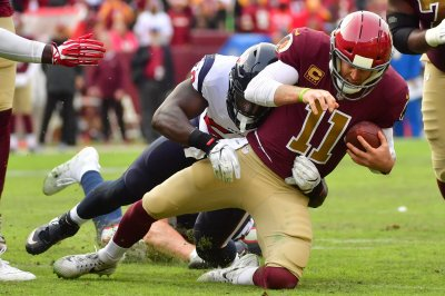 Redskins QB Alex Smith's injury not thought to be career ending