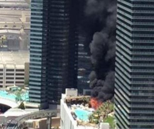 Officials: 2-alarm fire erupts at luxury hotel on Vegas Strip