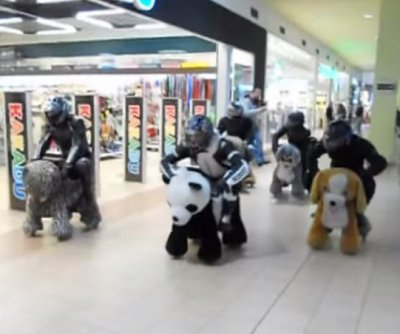 Slow-speed motorized animals race at Polish mall