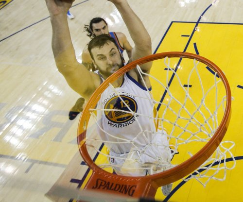 Golden State Warriors' Andrew Bogut to have MRI on knee