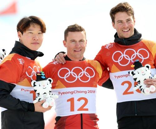 Switzerland's Galmarini wins men's parallel giant slalom at Winter Games