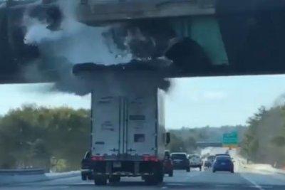 Watch: Semi truck's snow pile pulls down overpass net - UPI com