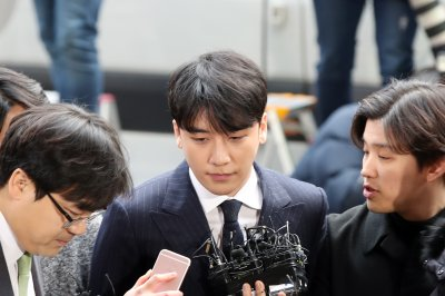Police question two K-pop stars over sex scandal