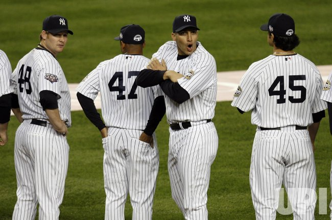 New York Yankees Andy Pettitte reacts to the cold weather while his team is introduced before playing the Philadelphia Phillies in game 1 of the World Series against the at Yankee Stadium in New York