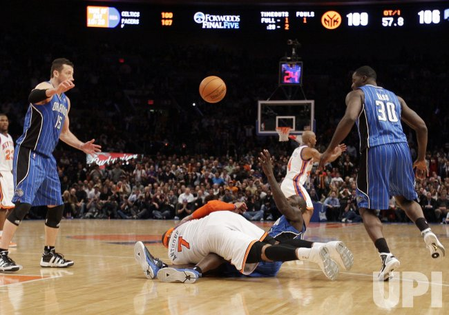 New York Knicks Carmelo Anthony and Orlando Magic Jason Richardson take turns tripping each other at Madison Square Garden in New York