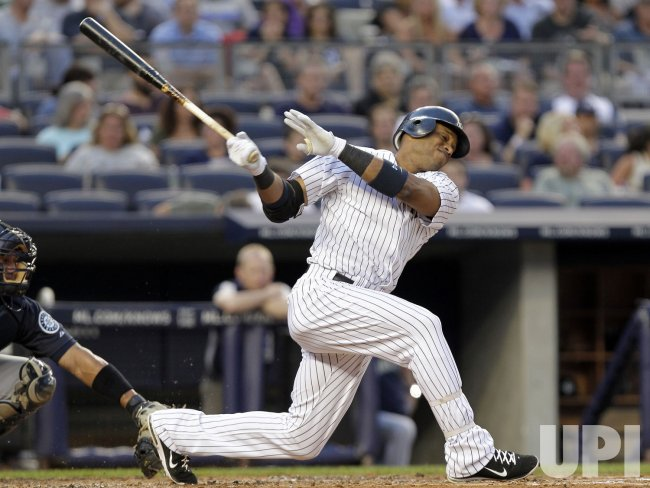 New York Yankees Robinson Cano reacts after striking out at Yankee Stadium in New York
