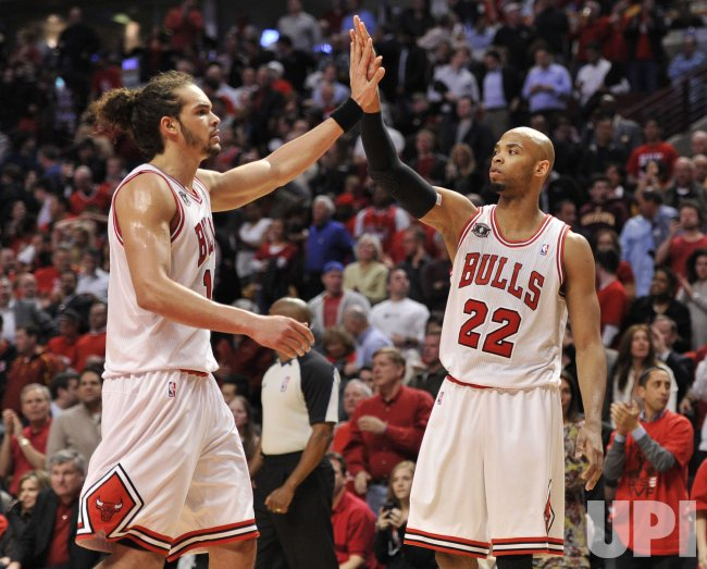 Bulls Noah high-fives Gibson against Hawks in Chicago