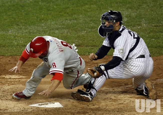 New York Yankees Jorge Posada tags out Philadelphia Phillies Shane Victorino at home plate in the ninth inning in game 1 of the World Series the at Yankee Stadium in New York