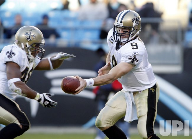 New Orleans Saints quarterback Drew Brees hands off to Ladell Betts against the Carolina Panthers in Charlotte, NC