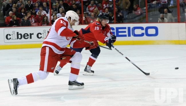 Capitals Backstrom defends shot attempts from Red Wings Datsyuk in Washington