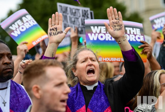 Demonstrators rally as the Supreme Court hears arguments on LGBTQ discrimination in Washington, DC
