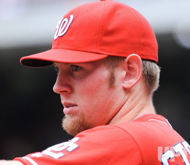 Nationals Stephen Strasburg watches warm-ups before game against the Phillies in Washington