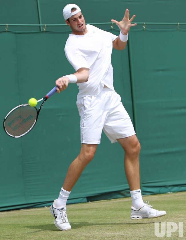John Isner plays a forehand at the Wimbledon Championships