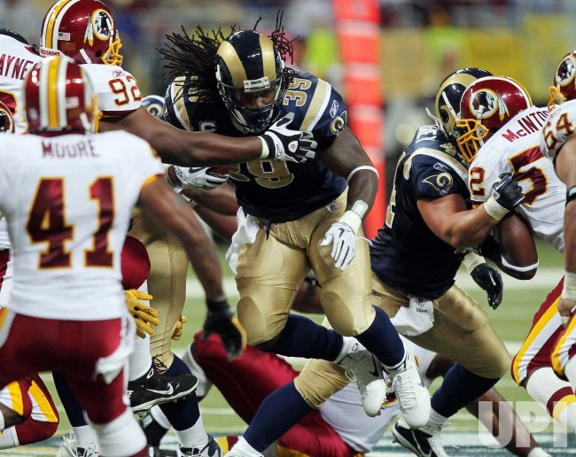 Rams' Steven Jackson is stopped by Redskins defense in St. Louis