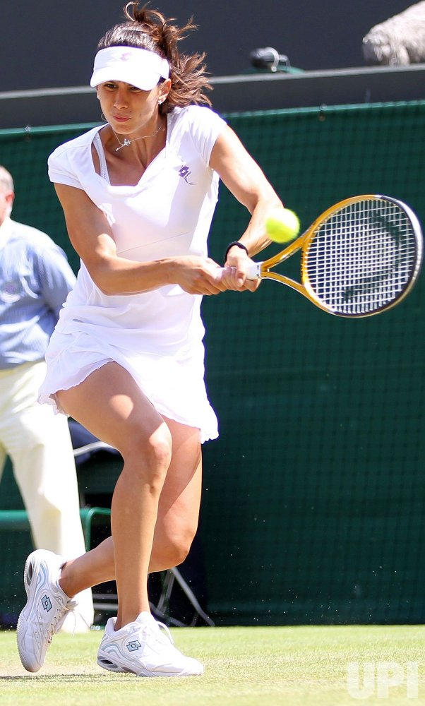 Pironkova plays backhand at the Wimbledon Championships