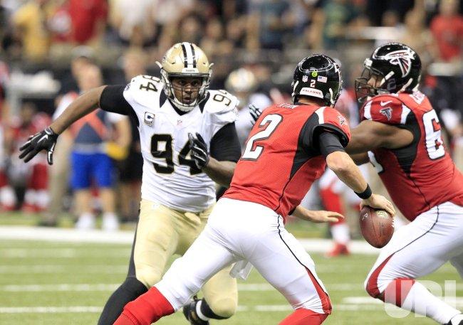 Saints defensive end Cameron Jordan pressures Falcons quarterback Matt Ryan