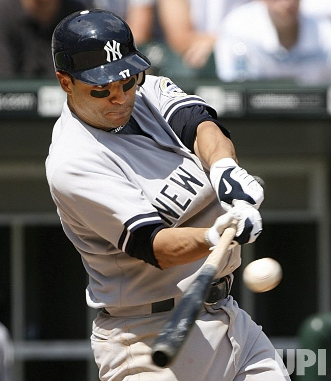 New York Yankees' Jerry Hairston Jr. singles against the Chicago White Sox