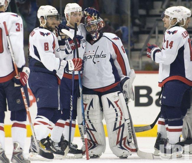 Capitals Goalie Theodore Receives Winning Hug in Denver