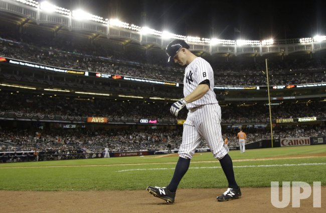 Yankees Brett Gardner reacts after grounding out to first base