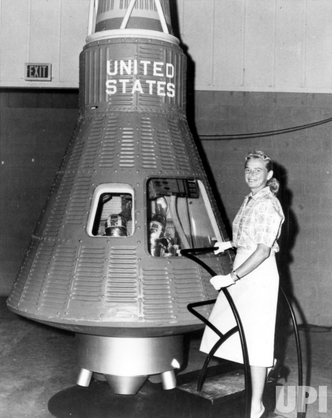 COBB NEXT TO THE MERCURY SPACECRAFT