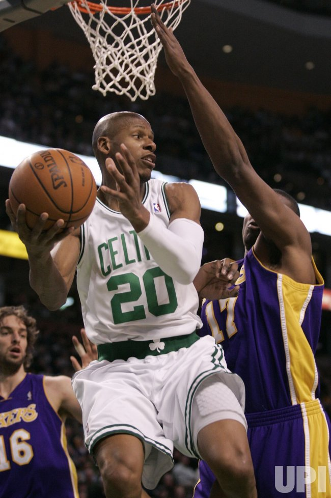 Celtics Allen passes against Lakers in Boston, MA.