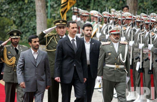 IRANIAN PRESIDENT AHMADINEJAD VISITS SYRIAN PRESIDENT BASHAR AL-ASSAD