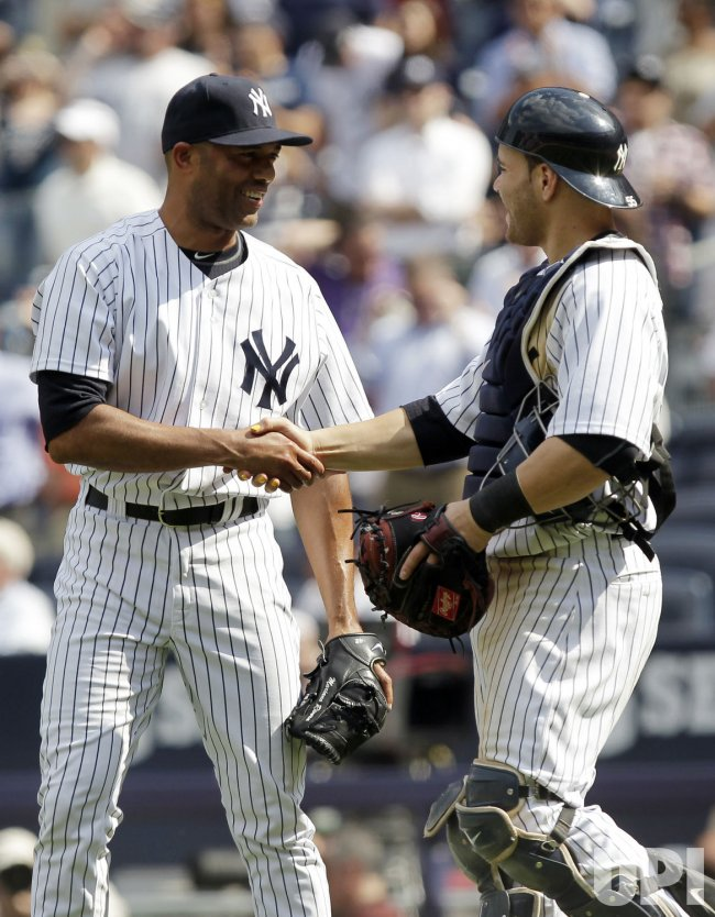 New York Yankees Russell Martin and closer Mariano Rivera shake hands at Yankee Stadium in New York