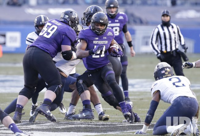 Northwestern Justin Jackson runs with the football