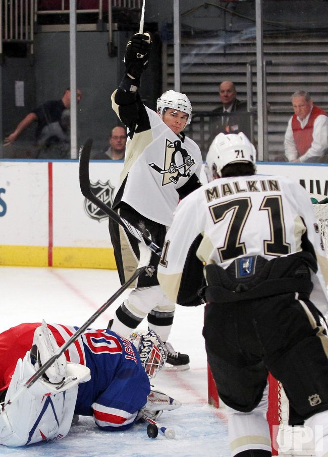 Pittsburgh Penguins Chris Kunitz reacts after a goal at Madison Square Garden in New York