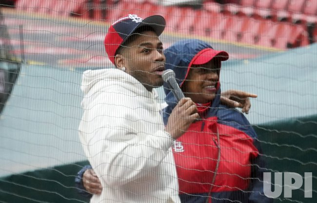 Singer Nelly Attends St. Louis Cardinals Baseball Game With Mother Rhonda Mack