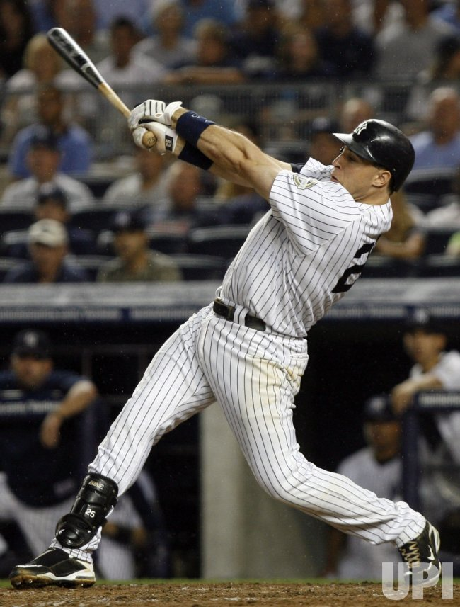 New York Yankees Mark Teixeira drives in 2 runs against the Texas Rangers at Yankee Stadium in New York