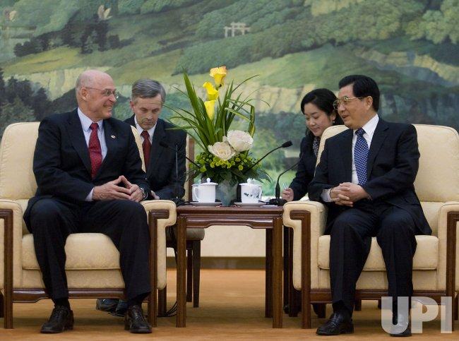 U.S. Treasury Secretary Paulson shakes hands with Chinese President Hu during the 5th U.S.-China Economic Dialogue in Beijing