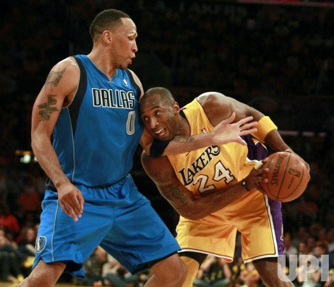 Los Angeles Lakers' Kobe Bryant, right, is defended by Dallas Mavericks Shawn Marion in the second half of Game 1 of the Western Conference semifinals in Los Angeles.