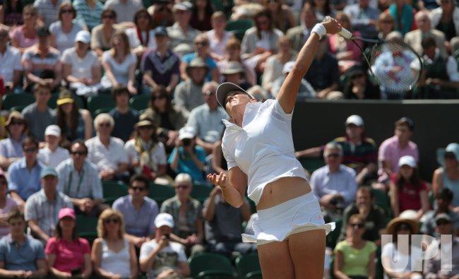 Laura Robson serves at 2013 Wimbledon Championships