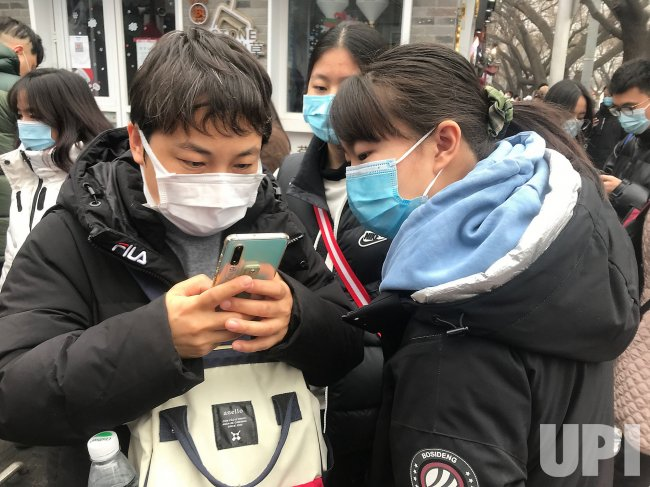 Chinese Prepare to Scan a Health QR Code in Beijing, China