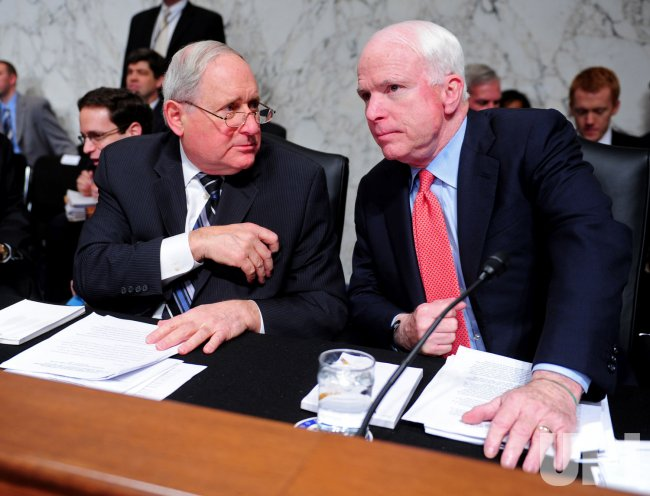 Sen. Carl Levin (D-IL) talks to Sen. John McCain (R-AZ) in Washington