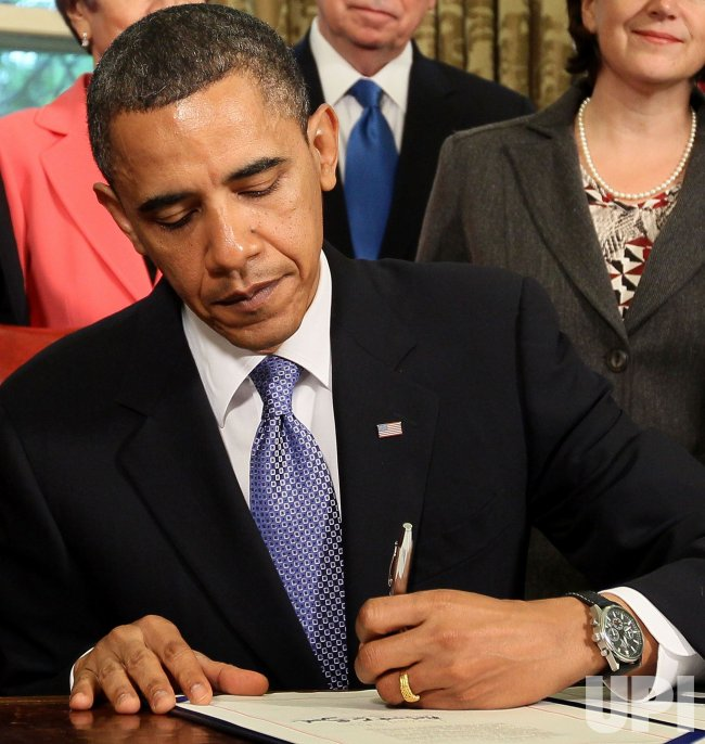 President Obama Signs Freedom Of Press Act At White House