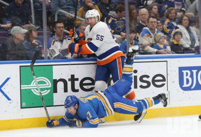New York Islanders Johnny Boychuk upends St. Louis Blues Jaden Schwartz